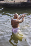 Holy bath in the river Ganges. Brahmin taking a holy bath in the waters of the holy river Ganges Royalty Free Stock Images