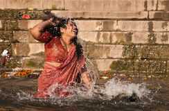 Holy bath in river Ganges in Varanasi Royalty Free Stock Image