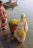 Holy bath in the river Ganges. Women in colorful saries taking a holy bath in the waters of the holy river Ganges Stock Images