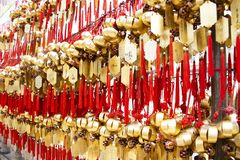 Holy bell on wall for respect praying at Wong Tai Sin Temple in Hong Kong, China stock photography