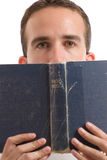 Holy Bible. A young man reading the Holy Bible, isolated against a white background Stock Photography