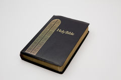Holy Bible. A photo of a Holy Bible with a black cover isolated on a white background Royalty Free Stock Photo