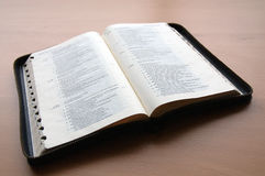 Holy bible. An open bible on a table, ready for reading the psalms Royalty Free Stock Photo