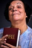 Holy bible. This picture represents a woman holding a holy bible Stock Images