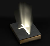 Holy bible. With shining cross over black background royalty free stock photo