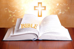 Holy bible. Open holy bible with peaceful light and cross Stock Photography