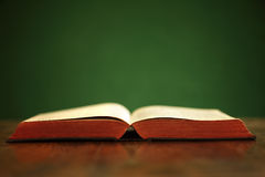 Holy Bible. Bible on table with green background and copy space Stock Photo