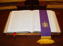 Holy Bible. Open Bible marked with a purple bookmark Stock Photos