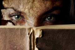 Holy Bible. Conceptual photo of old Bible and cracked face Royalty Free Stock Image
