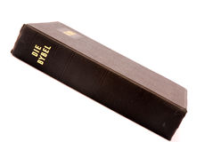 Holy bible. An old black bible in Afrikaans language from South Africa. Image isolated on white studio background Royalty Free Stock Photography
