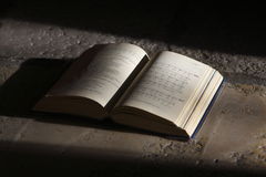 A Holy Bible. Lighting on an open church bible on the floor Royalty Free Stock Images