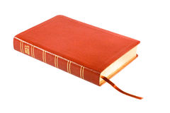Holy Bible. With the red leather cover (isolated on white Stock Photo