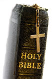 Holy bible. Close-up of old bible, with cross draped over spine of book stock photos