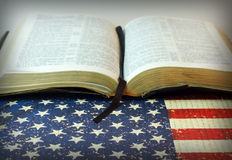 Holy Bible against an American Flag Royalty Free Stock Images
