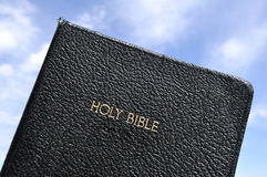 Holy Bible Against a Blue Sky. Copy Space Stock Images