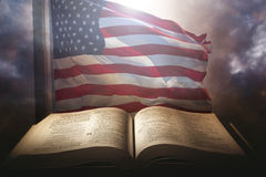 Holy Bible with the american flag. In the background Stock Photos