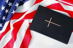 64f1731bd2d4 The Holy Bible and the American Flag. Holy Bible and American flag on a  light