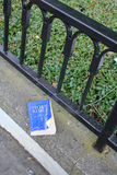 Holy Bible. Blue Holy Bible lies on a fence on the floor Stock Photography