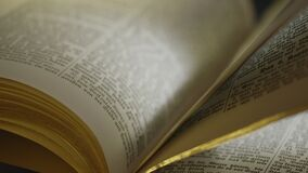 The holy bible book. Close up of old Holy bible book, camera track stock video footage