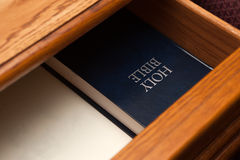 Holy Bible book in drawer. Holy Bible book lying in a open drawer Stock Image