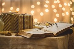 Holy bible book with eyeglasses Stock Images