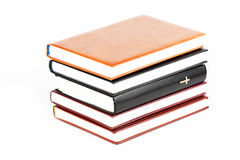 Holy Bible between books Royalty Free Stock Photo