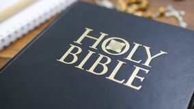 Holy Bible on Brown Wooden Table