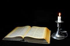 Holy Bible and candle Stock Photo
