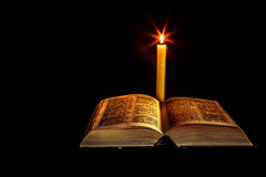 Holy Bible with candle Stock Photo
