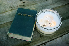 Holy Bible with Candle Stock Photography