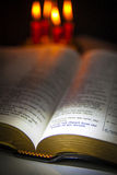 Holy Bible and Candles Royalty Free Stock Images