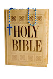 Holy bible with clipping path. Holy bible with blue rosary beads. Clipping path. Isolated on white Royalty Free Stock Photo