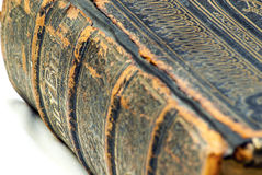 Holy bible closeup spine detail. A perspective shot of a vintage Holy Bible, with a worn spine and intricate pattern designs Stock Photo