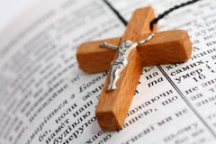 Holy Bible and cross. Close up of wooden cross on open Bible Royalty Free Stock Photography