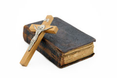 Holy bible with crucifix Stock Photos
