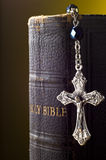 Holy bible and crucifix. Old leather Holy Bible and silver rosary crucifix Royalty Free Stock Photos