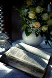 Holy Bible and Flowers on altar in the church Stock Photos