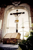 Holy Bible and Flowers on altar in the church Stock Images