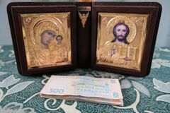 The Holy Bible Icons Surrounded With Money