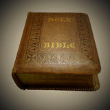 Holy Bible Inherited from Grandpa, under Vignetter. Old thick bible with yellow cover and golden characters Royalty Free Stock Image