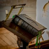 The Holy Bible on lectern. Old leather Bible on lectern in church, closed, with marker ribbons royalty free stock image