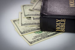Holy Bible and money Stock Photos