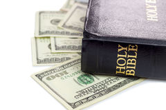 Holy Bible and money Royalty Free Stock Images