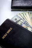 Holy Bible and money Stock Images