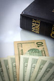 Holy Bible and money Royalty Free Stock Photography