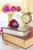 Holy Bible and old gold alarm clock on wood table Stock Photography