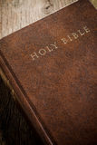 The Holy Bible on old wooden table Royalty Free Stock Photo