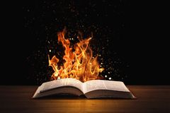 Free Holy Bible On Fire On A Wooded Desk Stock Images - 160063274