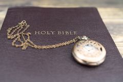 Holy bible and pocket watch for background royalty free stock images