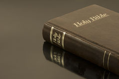 Holy Bible on Reflective Surface (Horizontal) Stock Photography